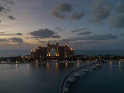 Aerial view of the luxurious Palm Jumeirah Atlantis Hotel and monorail at night in Dubai, United Arab Emirates. - AAEF03249