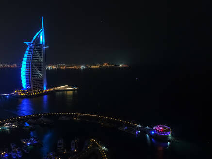 Aerial view of the luxurious Burj Al Arab Hotel by night in Dubai, United Arab Emirates. - AAEF03324