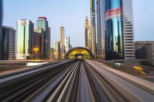 POV on the modern driverless Dubai elevated Rail Metro System, running alongside the Sheikh Zayed Road, Dubai, United Arab Emirates, Middle East - RHPLF01092