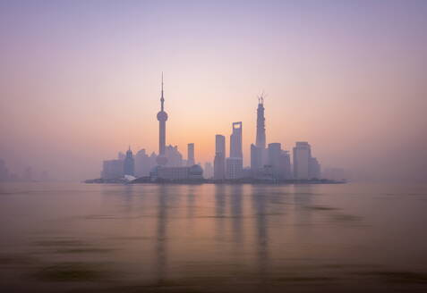 Pudong skyline across Huangpu River, including Oriental Pearl Tower, Shanghai World Financial Center, and Shanghai Tower, Shanghai, China, Asia - RHPLF01107