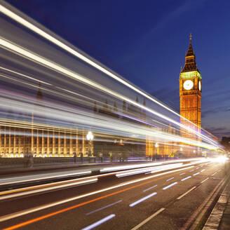 Motion blurred red double decker bus, Houses of Parliament, Big Ben, Westminster Bridge, London, England, United Kingdom, Europe - RHPLF01155