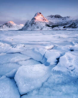 Frozen lake in front of mountain in the early morning light, Lofoten Islands, Nordland, Norway, Europe - RHPLF01680