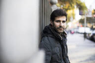Portrait of a man looking at camera in a street in Madrid, Spain. - ABZF02432