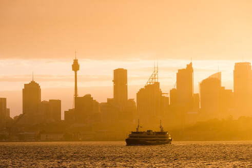 Sydney city skyline looking towards the sun with ferry, Sydney, New South Wales, Australia, Pacific - RHPLF01915