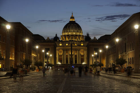 St. Peter's Cathedral night view with passing crowd, from Via della Conciliazione, Rome, Lazio, Italy, Europe - RHPLF01936
