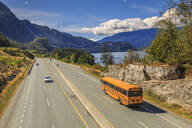 Yellow school bus on The Sea to Sky Highway near Squamish, British Columbia, Canada, North America - RHPLF02173