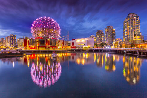 View of False Creek and Vancouver skyline, including World of Science Dome at dusk, Vancouver, British Columbia, Canada, North America - RHPLF02200