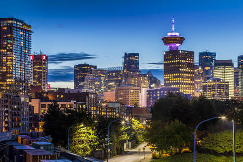 View of city skyline and Vancouver Lookout Tower at dusk from Portside, Vancouver, British Columbia, Canada, North America - RHPLF02209