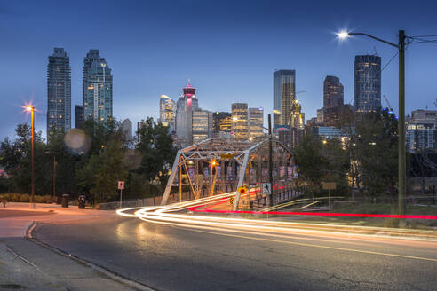 Car trail lights through Macdonal Avenue bridge and Downtown skyline at dusk, Calgary, Alberta, Canada, North America - RHPLF02389