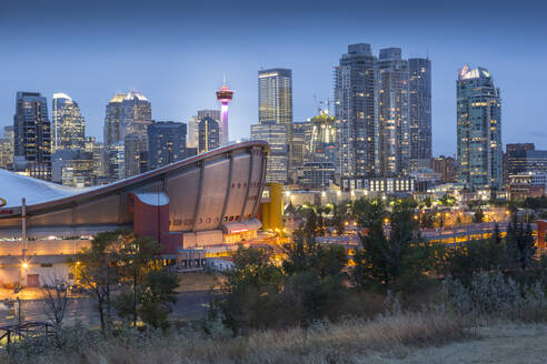 View of the Saddledome and Downtown skyline from Scottsman Hill at dusk, Calgary, Alberta, Canada, North America - RHPLF02392