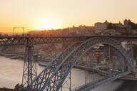 Ponte Dom Luis I Bridge at sunset, Ribeira District, UNESCO World Heritage Site, Porto (Oporto), Portugal, Europe - RHPLF02605