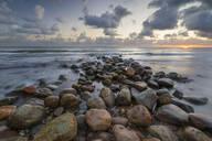 Rock breakwater in sea at sunrise, Munkerup, Kattegat Coast, Zealand, Denmark, Scandinavia, Europe - RHPLF02848