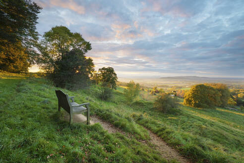 Cotswold Way path and bench with views to the Malvern Hills at sunset, Ford, Cotswolds, Gloucestershire, England, United Kingdom, Europe - RHPLF02854