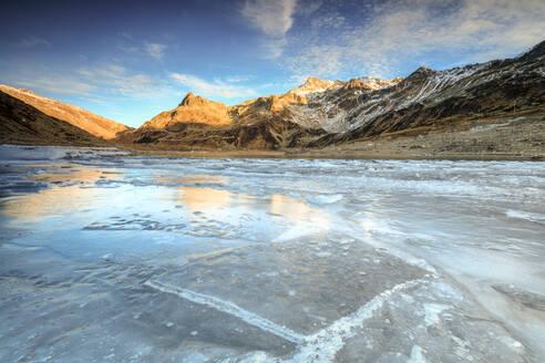 Frozen lake Montespluga at dawn, Chiavenna Valley, Sondrio province, Valtellina, Lombardy, Italy, Europe - RHPLF02908