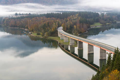 Sylvenstein Lake and bridge surrounded by the morning mist, Bad Tolz-Wolfratshausen district, Bavaria, Germany, Europe - RHPLF03348