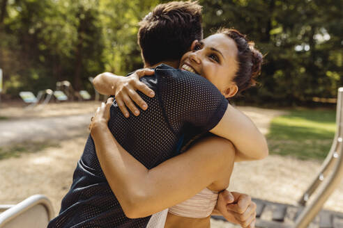 Man and woman hugging on a fitness trail - MFF04838