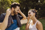 Sporty man and woman talking in a park - MFF04853