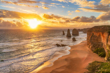 Scenic view of sea against cloudy sky at Twelve Apostles Marine National Park during sunset, Victoria, Australia - SMAF01313