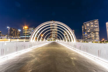 Illuminated Webb Bridge in Docklands against clear sky at night, Melbourne, Australia - SMAF01319