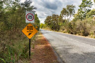 Wallaby crossing sign road against sky - SMAF01322