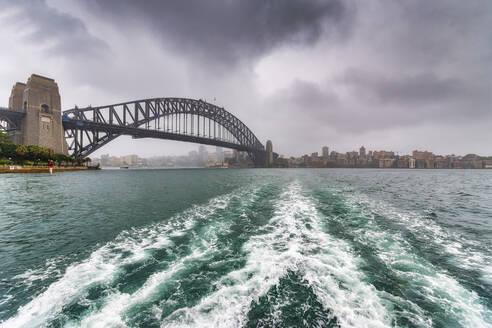Sydney Harbor Bridge over river against cloudy sky - SMAF01331