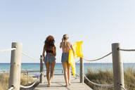 Son Bou beach, Menorca, Spain. Summer time. Two friends at the beach - JPTF00250