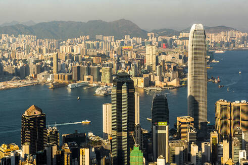 View across Victoria Harbour, from Hong Kong Island to Kowloon, seen from Victoria Peak, Hong Kong, China, Asia - RHPLF03599