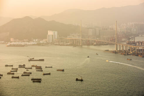 Boats in Victoria Harbour at sunset, seen from Victoria Peak, Hong Kong Island, Hong Kong, China, Asia - RHPLF03602