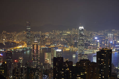 View at night of central Hong Kong and Victoria Harbour from Victoria Peak, looking toward Kowloon in background, Hong Kong, China, Asia - RHPLF03631