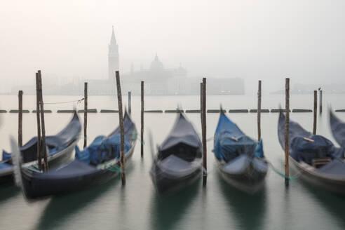 Gondolas in the fog with the Church of San Giorgio Maggiore in the background, Venice, UNESCO World Heritage Site, Veneto, Italy, Europe - RHPLF03904