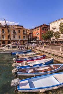 View of boats in Malcesine Harbour by the Lake, Malcesine, Lake Garda, Veneto, Italian Lakes, Italy, Europe - RHPLF04258