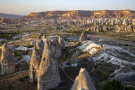 Scenic view of Goreme Open Air Museum against clear sky during sunset, Cappadocia, Turkey - KNTF03035