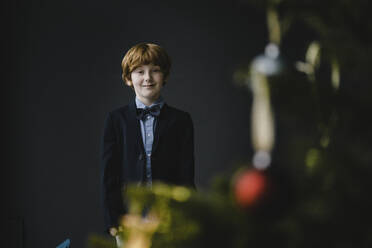 Portrait of redheaded boy wearing bow tie at Christmas time - KNSF06281