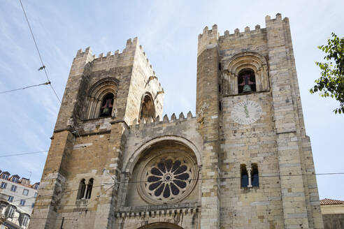 Low angle view of Lisbon Cathedral in city, Portugal - WIF03989