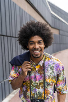 Portrait of happy man wearing colorful shirt - AFVF03870
