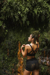 Sportive young woman with braids in forest - LJF00732