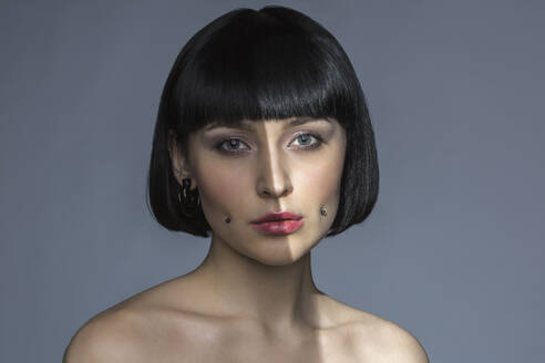 Portrait of young woman with cheek piercing - VGF00294