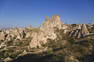 Uchisar castle against clear blue sky at Cappadocia, Turkey - KNTF03132