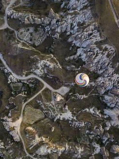 Aerial view of hot air balloon flying at Goreme National Park, Cappadocia, Turkey - KNTF03135
