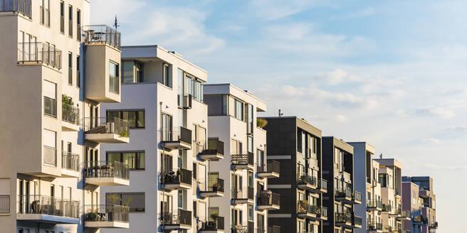 Exterior of modern residential buildings against sky in Frankfurt, Germany - WDF05422