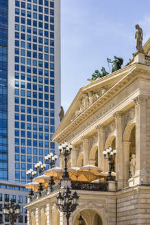 Low angle view of Frankfurt Old Opera House and skyscraper against sky, Germany - WDF05449