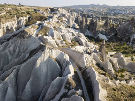 Aerial view of road on tuff formations at Goreme, Cappadocia, Turkey - KNTF03190
