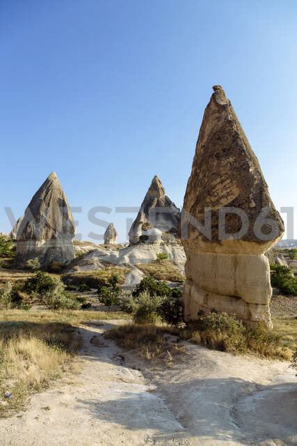 Scenic view of Dove complex monastery against clear blue sky at Goreme National Park, Cappadocia, Turkey - KNTF03208 - Konstantin Trubavin/Westend61