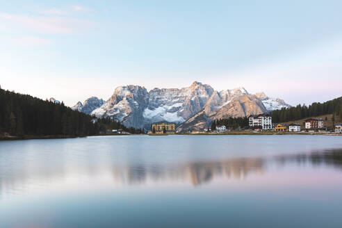 Scenic view of Lake Misurina and mountains against sky during sunrise, Italy - WPEF01812