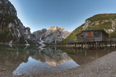 Scenic view of Braies lake against clear blue sky during sunrise, Italy - WPEF01833