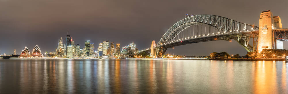 Panoramic shot of illuminated Sydney Harbor Bridge over river at Sydney, Australia - SMAF01418
