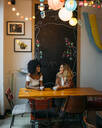 Multicultural women talking in a cafe - MPPF00029