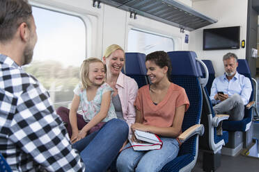 Carefree family traveling in a train - FKF03605