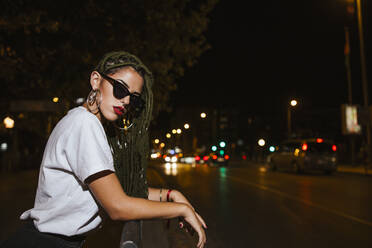 Cool young woman on a steet at night in the city - LJF00786