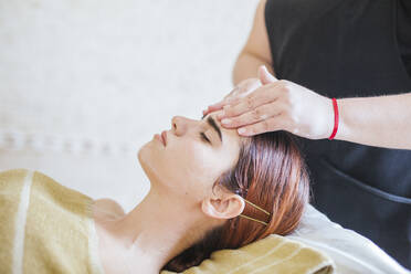 Young woman receiving facial beauty treatment in a spa - LJF00862